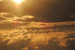 Zonsondergang vanuit trein Amsterdam